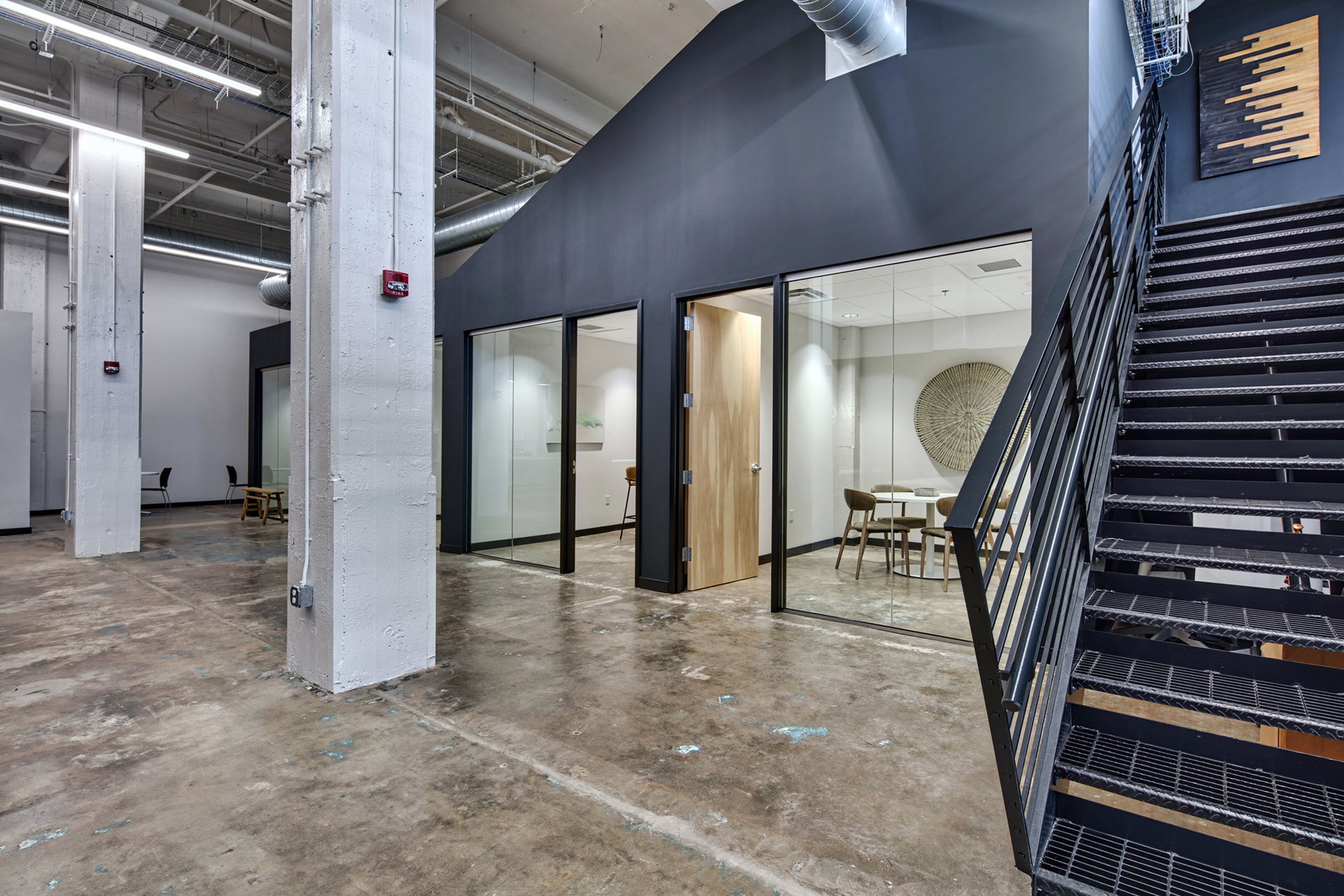 Lobby with staircase and view of office spaces at The Denham Building loft apartments for rent in South Birmingham, AL