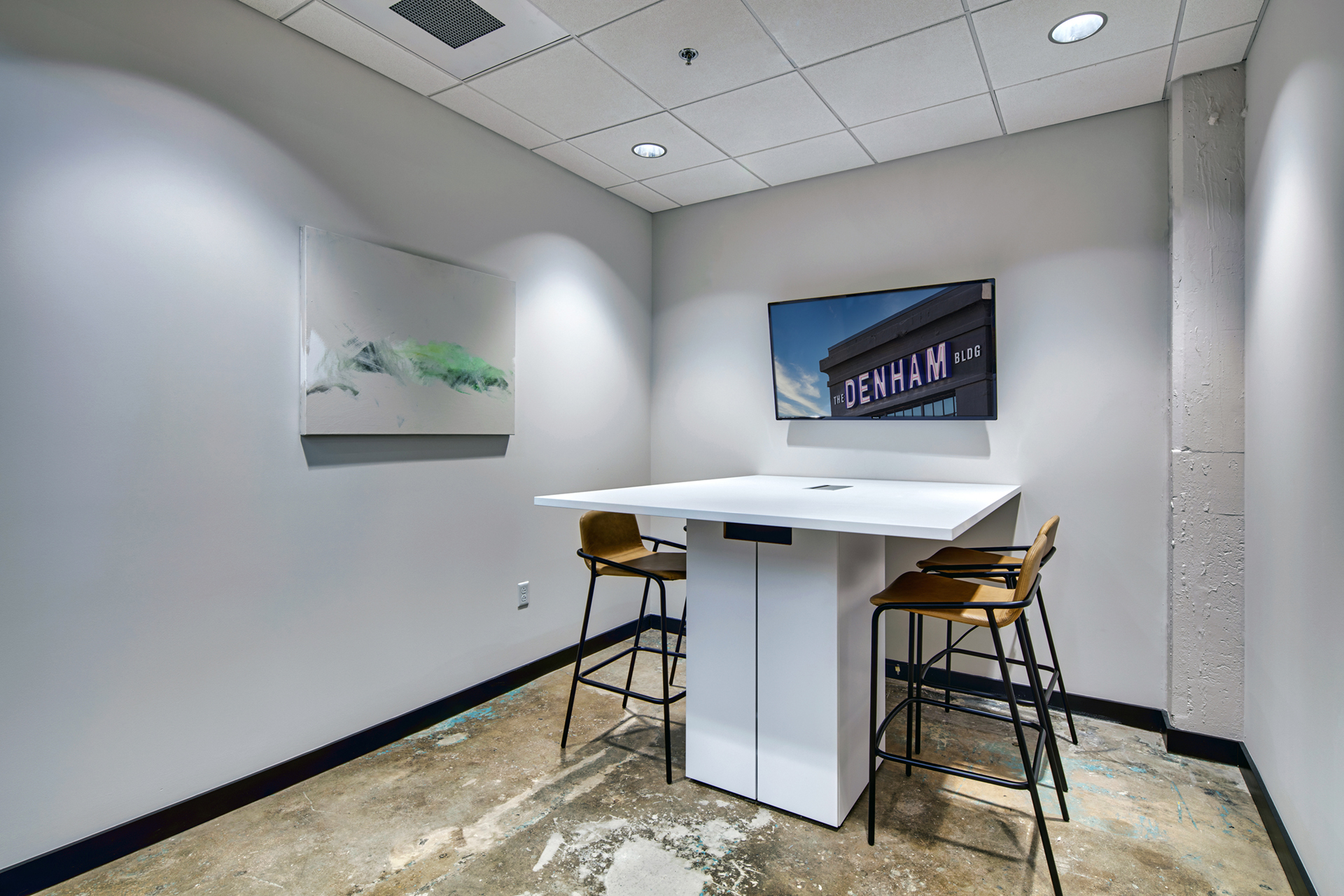 Office space with seating area for working professionals at The Denham Building in South Birmingham, AL