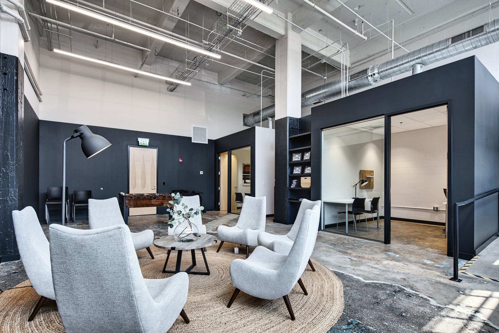 Lobby with seating area for working professionals at The Denham Building loft apartments for rent in South Birmingham, AL