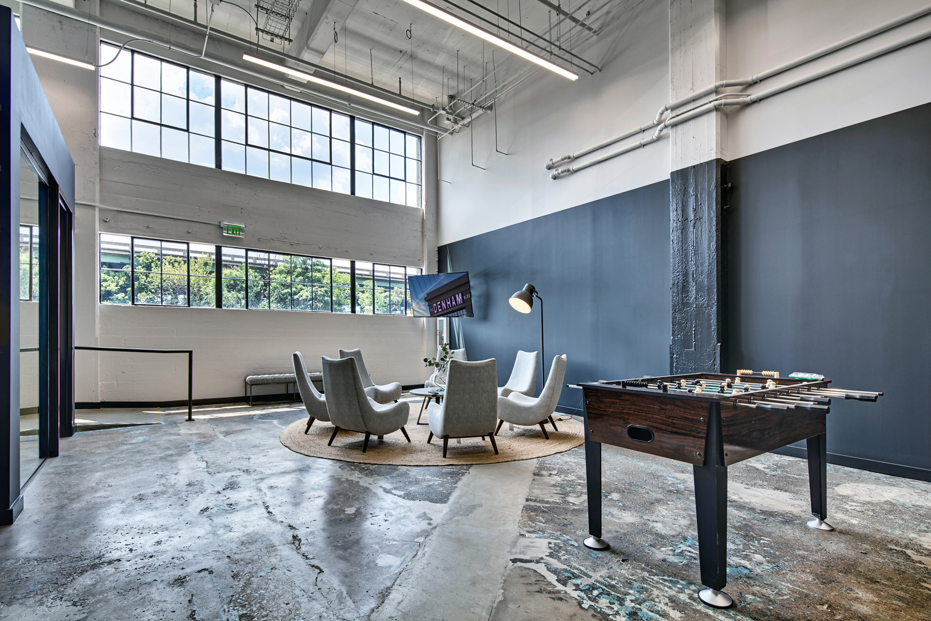 Lobby with seating area at The Denham Building loft apartments for rent in South Birmingham, AL