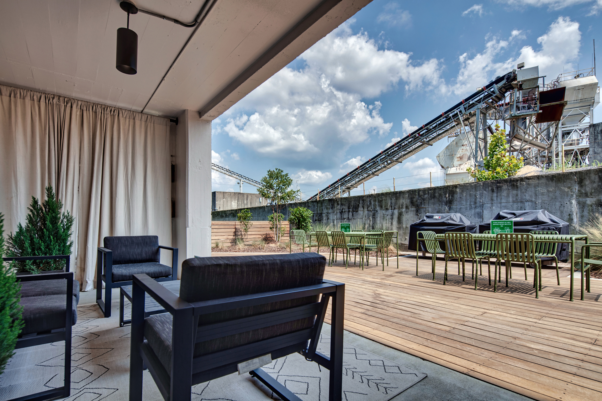 Outdoor patio with ample seating at The Denham Building loft apartments for rent in South Birmingham, AL