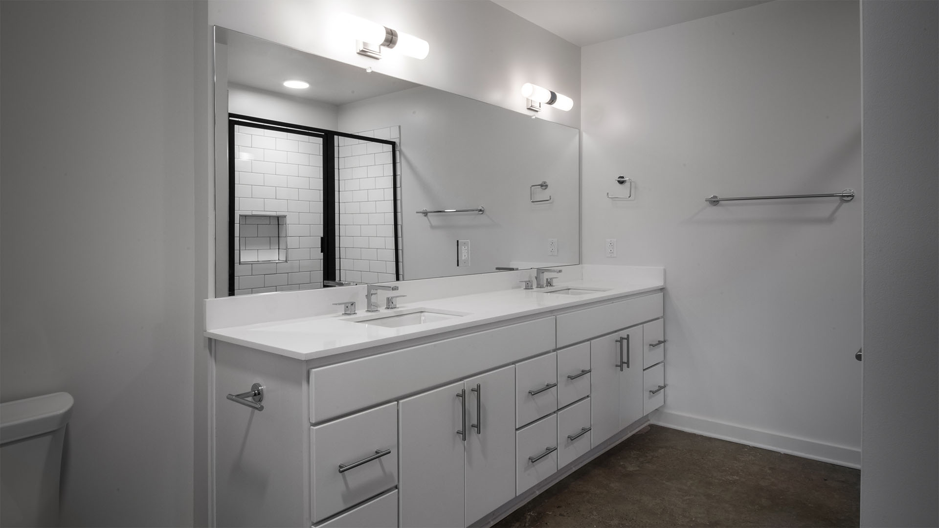 Large bathroom with double sink vanity at The Denham Building loft apartments for rent in South Birmingham, AL